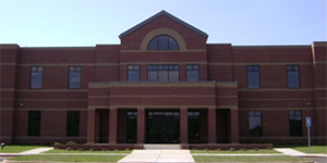 Photo of the brown brick front of the Shared Services Center building located in Sandersville, Georgia.